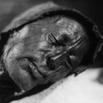 Solemn mummified face of 2,000 year-old Tollund Man.