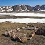 Inuit gravesite with weather-collapsed Christian crosses.