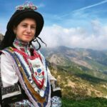 Sarakatsani young woman in traditional costume, Pindus Mountains, Greece, photo SlavaBogur, 2008, Wikipedia photo. For this poem, Diōnē.