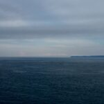 From Quoddy Head Light peering east across Bay of Fundy to Grand Manan Island.